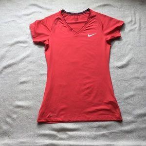 Nike pro dri-fit orange short sleeve top size M